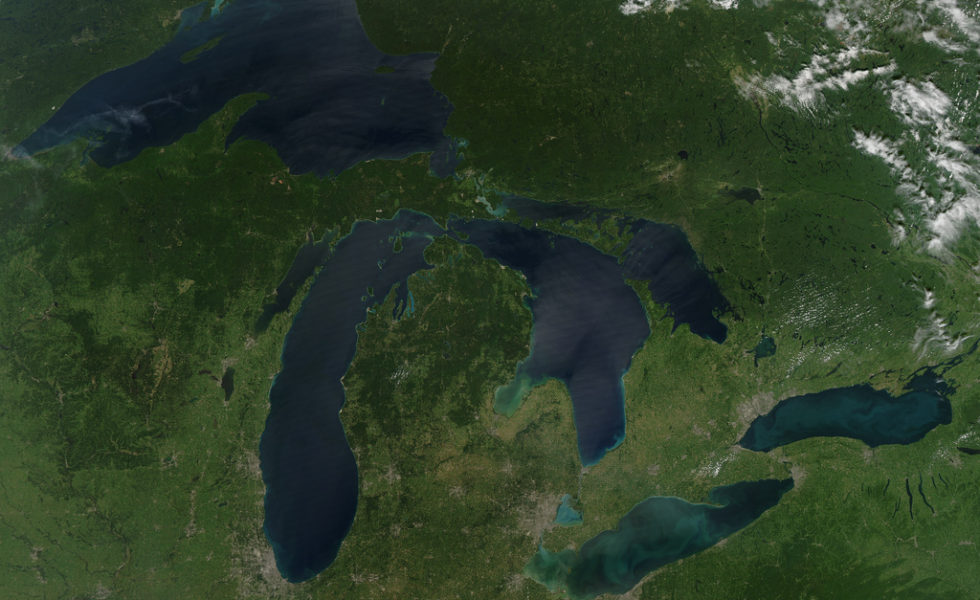 NASA image acquired August 28, 2010  Late August 2010 provided a rare satellite view of a cloudless summer day over the entire Great Lakes region. North Americans trying to sneak in a Labor Day weekend getaway on the lakes were hoping for more of the same. The Great Lakes comprise the largest collective body of fresh water on the planet, containing roughly 18 percent of Earth's supply. Only the polar ice caps contain more fresh water. The region around the Great Lakes basin is home to more than 10 percent of the population of the United States and 25 percent of the population of Canada. Many of those people have tried to escape record heat this summer by visiting the lakes. What they found, according to The Hamilton Spectator, was record-breaking water temperatures fueled by record-breaking air temperatures in the spring and summer. By mid-August, the waters of Lake Superior were 6 to 8°C (11 to 14°F) above normal. Lake Michigan set records at about 4°C (7°F) above normal. The other three Great Lakes – Huron, Erie, and Ontario -- were above normal temperatures, though no records were set. The image was gathered by the Moderate Resolution Imaging Spectroradiometer (MODIS) on NASA's Aqua satellite at 1:30 p.m. Central Daylight Time (18:30 UTC) on August 28. Open water appears blue or nearly black. The pale blue and green swirls near the coasts are likely caused by algae or phytoplankton blooms, or by calcium carbonate (chalk) from the lake floor. The sweltering summer temperatures have produced an unprecedented bloom of toxic blue-green algae in western Lake Erie, according to the Cleveland Plain Dealer. .References .Environmental Protection Agency. (n.d.) The Great Lakes Atlas. Accessed September 3, 2010. .The Cleveland Plain Dealer. (August 22, 2010) Scientists say the toxic blue-green algae will only get worse on Ohio lakes. Accessed September 3, 2010. .The Hamilton Spectator. (August 13, 2010) Great Lakes turn to 'bath water.' Accessed September 3, 2010. NASA imag